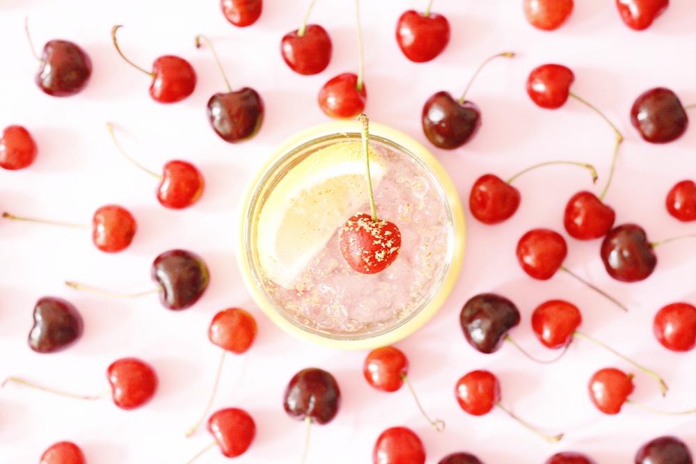 Summer Cherry Fix with Rum, lemon, sugar, and cherries.